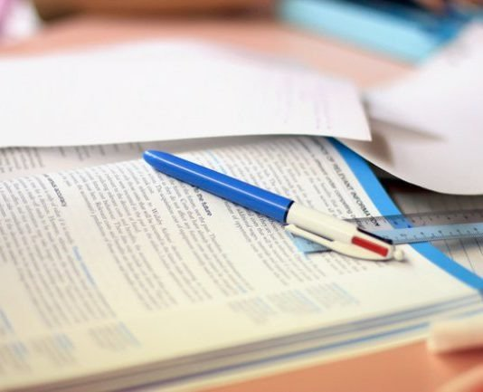 characteristics of a good textbook: pen on open book