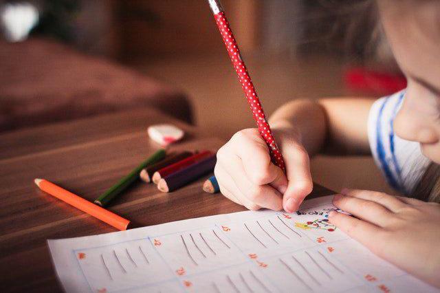 Dyslexia - little girl writing