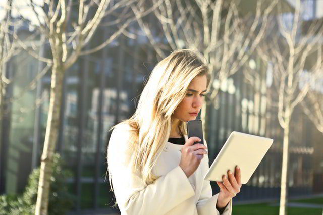 mobile learning - woman holding tablet and smartphone.