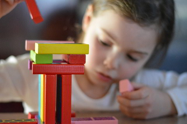 little girl with building blocks
