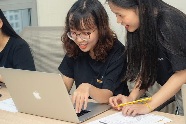 two young girls doing online activities