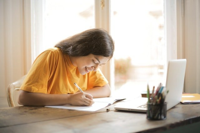 student writing for her gmat score