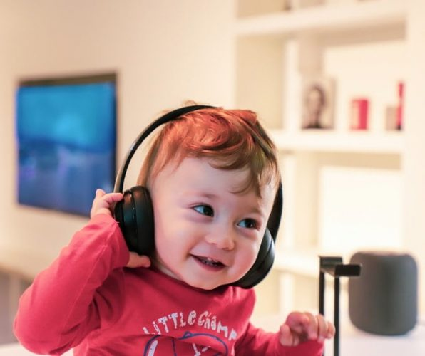 young child listens to music